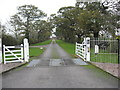 SJ6062 : Entrance gates and driveway to Holmston Hall, Caravan Site and Fishery by Dr Duncan Pepper