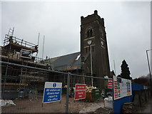 SK4055 : House building and church re-roofing by Peter Barr