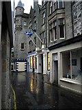 HU4741 : Commercial Street (main street), Lerwick (on a wet day) by Robert W Watt