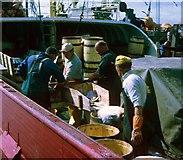 HU4841 : Norwegian klondykers salting herring prior to packing by Robert W Watt