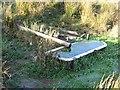 NT5154 : Bath in a field by Richard Webb