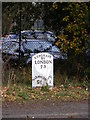 TM2245 : Milepost on the A1214 Woodbridge Road by Adrian Cable