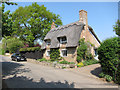 TL2777 : Thatched house, Broughton by Hugh Venables