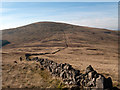 NX5191 : Dry stone wall connecting Cairnsgarroch and Meaul by Trevor Littlewood