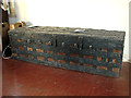 TM1861 : St Andrew's church in Winston - iron-bound chest by Evelyn Simak