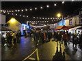 SJ8976 : Prestbury Christmas Street Party by Peter Turner