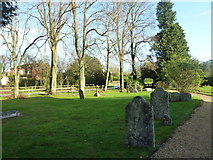 SU5355 : All Saints, Hannington: gravestones by Basher Eyre