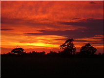 TM0663 : Sunset from Ash Tree Farm, west of Gipping by Colin Park