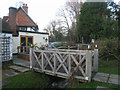 SU4763 : Footbridge in pub garden by Given Up