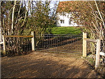 TM3667 : The gated  entrance to Corner Farm by Adrian Cable