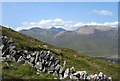 NG5526 : Hill slope with ruined wall - north ridge of Glas Bheinn Mhòr by Trevor Littlewood
