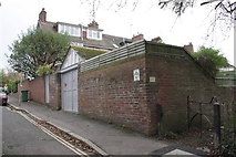 SX9193 : Side wall of #26 Velwell Road and rear footpath by Roger Templeman