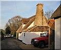 TL4962 : Dock Lane: rebuilt cottage by John Sutton