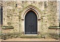 TQ2569 : St John the Divine, High Path, Merton - Doorway by John Salmon