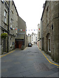 HU4741 : Commercial Street past the Queens Hotel, Lerwick by Rob Farrow