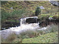 NY7975 : Small Waterfall, Middle Burn, Stonehaugh by Les Hull