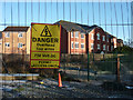 SJ8293 : Warning notice on Metrolink line fencing by Phil Champion