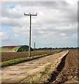 TG4019 : Access track to Ludham airfield by Evelyn Simak