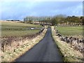 NZ0174 : Old road to Kirkheaton by Oliver Dixon