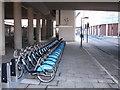 TQ2380 : Boris bikes at Westfield, NE docking station by David Hawgood