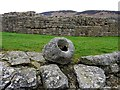 NY7666 : Stone vessel and north-west wall of Roman Fort by Andrew Curtis