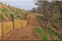 NT5675 : Retaining fence, River Tyne Path by Jim Barton