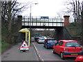 SJ4287 : Disused railway bridge over Belle Vale Road by JThomas