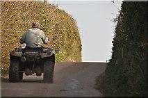 SS9619 : Mid Devon : Quad Bike on Cove Hill by Lewis Clarke