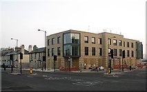 TL4557 : New building on railway land by John Sutton