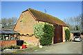 SU5894 : A farm barn which has an Ordnance Survey benchmark by Roger Templeman