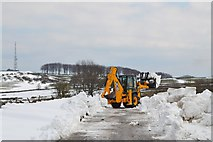 SK2077 : Clearing April snow east of Bretton by Neil Theasby