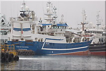 NJ9967 : Modern trawlers in Fraserburgh harbour by Roger Davies