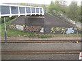 SK3889 : Footbridge abutment and flank walls by Robin Stott