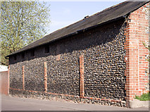 TL5646 : Flint and brick building by M H Evans
