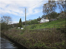 SJ2442 : The canal passes Trevor Uchaf by Ian S