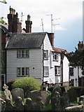 TQ8833 : Houses by St Mildred's Church graveyard by Oast House Archive