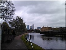 TQ3681 : View of Canary Wharf and the sewer ventilation column from the Regent's Canal by Robert Lamb