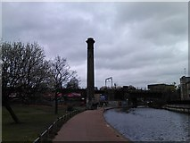 TQ3681 : View of the sewer ventilation column from the Regent's Canal by Robert Lamb