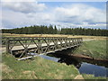 NY6676 : A bridge over the River Irthing by Ian S