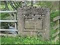 NU0335 : Inscription on Holburn Mill Bridge by Graham Robson