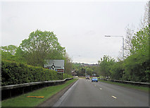NS3881 : Roundabout at entrance to Loch Lomond Shores by John Firth