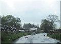 NY7801 : B6259 south entering Outhgill by John Firth