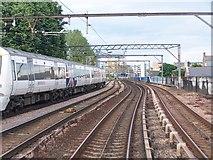 TQ3581 : Docklands and mainline railway tracks on viaduct next to Barnardo Street by David Martin