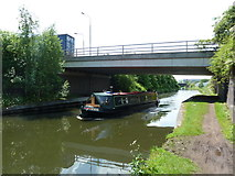 SJ7996 : Bridgewater Canal with Europa Gate above, plus narrowboat by Alexander P Kapp