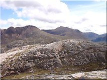 NG9981 : Rocky crag east of Creag-mheall Mor by Sally