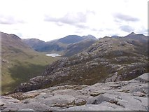NG9981 : On a rocky crag east of Creag-mheall Mor by Sally