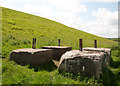 SE9764 : Large concrete blocks in Cottam Well Dale by Neil Oakes