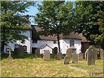 SX7087 : Cottages and churchyard, Chagford by Derek Harper
