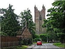 TL4568 : Cottenham: All Saints' tower from Twentypence Road by John Sutton