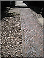 SP2864 : Paving, Lord Leycester Hospital forecourt by Robin Stott